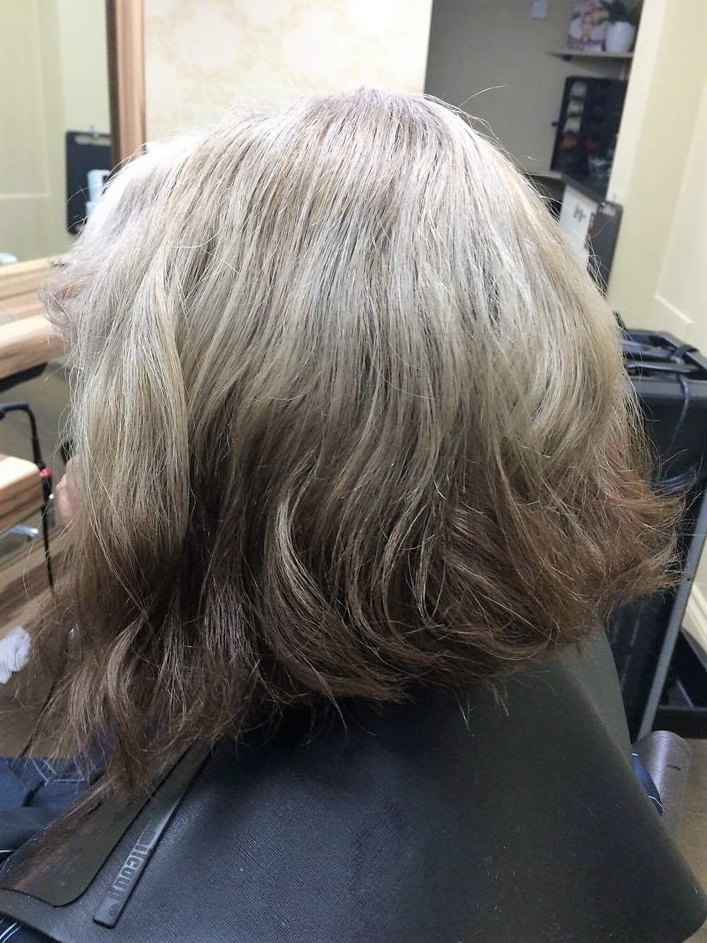 Client wanted complete change. She likes it white at the front to hide the natural grey, cool blonde as a base colour but some darker blended ends to give a contrasting look.
