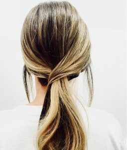 Woman from behind with casual hair style, showing sleek, natural-looking hair from Kevin.Murphy